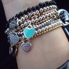Stack of Tiffany & Co. bracelets? Yes please!