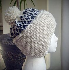 The construction of this hat was inspired by one pictured in a magazine published around 1910. Knitting the headband side to side provides a double layer of garter stitch to keep the ears warm, and allows for easy shaping of the earflaps. The edges of the headband are folded together along a slipped stitch seam, and picked up together to finish in the round. The hat has plenty of depth so it can be pulled low on the forehead, and the earflaps will naturally cup around the ears to keep them… Crochet Girls, Knit Crochet, Double Knitting, Baby Knitting, Crochet Beanie Hat Free Pattern, Cloche Hat, Garter Stitch, Ear Warmers, Yarn Crafts