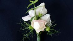 Buttonhole with Rose, Sweet peas and Nigella seed heads.