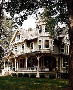 This is a Victorian house. I know that because it has a wrap around porch, turret, and the gable roof.