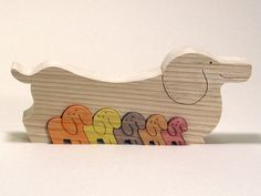 A cute wooden puzzle is designed by Japanese master wood craftsman, Oguro Saburo. It is a wooden puzzle of lovely Dachshund, painted with a cute colour combination. Your children can feel warmth of wood with the Animal Building Blocks. Dachshund Gifts, Dachshund Love, Dog Restaurant, Monster Box, Art Carte, Toys For Tots, Animal Puzzle, Weenie Dogs, Animal Decor