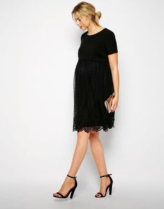 Modest black maternity dress with sleeves | Follow Mode-sty for stylish modest clothing #nolayering