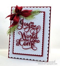Good morning and Merry Christmas. My Christmas morning project was made using the Impression Obsession Joy to the World sentiment die and paired with the Pine Pair and Lawn Fawn Scalloped Rectangle