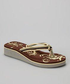 Look at this #zulilyfind! Brown Ribbon Wedge Flip-Flop - Women by Rockin Footwear #zulilyfinds    http://www.zulily.com/invite/aferguson421