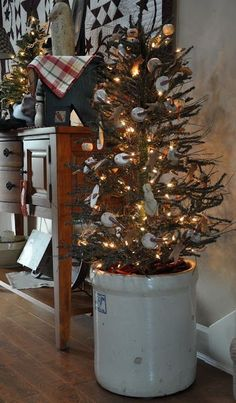 Prim Christmas Tree...in an old stoneware crock. Going to use this idea in my kitchen this year. Love