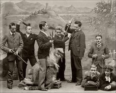 """The Hunting of the Snark   """"That's exactly the way I have always been told  That the capture of Snarks should be tried!"""" (Lewis Carroll, The Hunting of the Snark)   The painted backdrop indicates that this photograph had been taken in the Rhineland (Germany), the studio remains unidentified.  I suppose that they are students fooling around."""