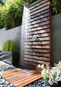 Outdoor garden shower in Wonderland Park Residence by Fiore Landscape Design.