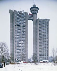Genex Tower, or Western City Gate, is a 35-story skyscraper in Belgrade, Serbia, which was designed in 1977 by Mihajlo Mitrović in the brutalist style.  It is formed by two towers connected with a two-story bridge and revolving restaurant at the top.