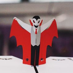 Adorable or terrifying? This little 3D pop up Vampire is a perfect fit with both Halloween adjectives! He's a great paper art surprise for the best Halloween party Hostess. #popupcard