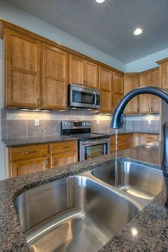 slate floor in kitchen tropical brown granite with maple cabinets search 5310