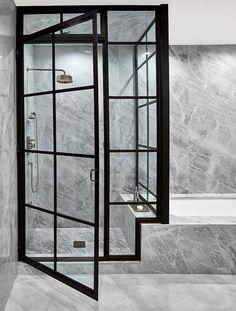 Bathroom Design Idea: Marble walls, flooring and dark frame shower stall #bathremodel #bathrenovation
