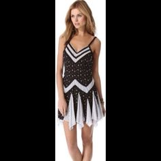 Black & White Patterned Trapeze Slip V-neck adjustable spaghetti strap trapeze slip from Intimately Free People. Polka dots and flowers are patterned throughout. 100% rayon. Free People Intimates & Sleepwear Chemises & Slips