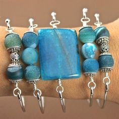 Learn to use Bead Gallery beads to make a bangle bracelet perfect for stacking! Bead caps and metal beads add texture alongside semi-precious stones.
