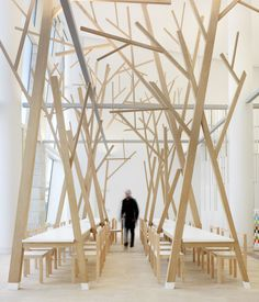 Estudio Nomada   Created for the cafe in Galicia, Spain's City of Culture building, the sweetly sparse oak braches and long communal tables impart a feeling of community.