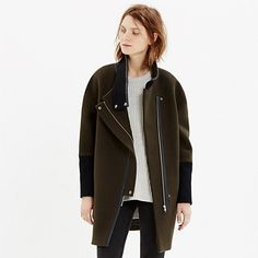 This sleek sculptural coat gives a laid-back nod to biker style (see: stand-up collar and zips on the sleeves) while being completely now. An update on a timeless cocoon shape in a versatile colorblock, this design-team favorite is one to layer over sweaters and dresses alike—the covered asymmetrical zip will keep things cozy.  <ul><li>True to size.</li><li>Wool/nylon.</li><li>Dry clean.</li><li>Import.</li></ul>
