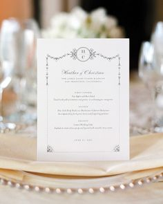 The stately flourishes on this menu card were inspired by Beaux-Arts architecture