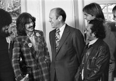 President Gerald Ford smiles as he talks with George Harrison, Billy Preston and Ravi Shankar at the White House in 1974. (AP Photo/Charles Bennett)