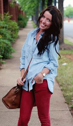 Marry a light blue denim shirt with red skinny jeans for a knockout outfit.