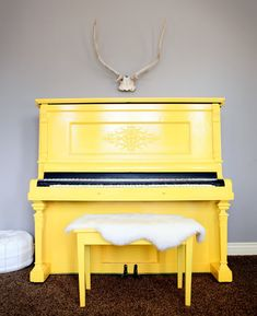 This yellow piano is playing music before your fingers hit the keys....lovely!