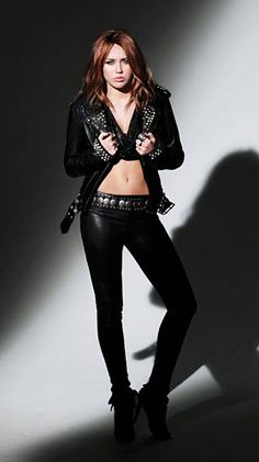 Miley Cyrus in a leather outfit Cover Of The Can't Be Tamed CD