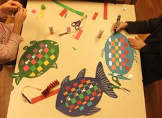 paper weaving for kids | Paper Weaving: Rainbow Fish (January 2012) | Hannah's Art Club