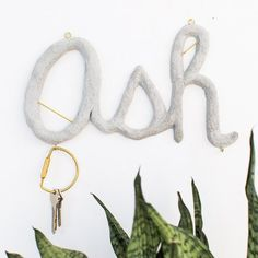 Stay organized with this DIY Hanging Concrete Monogram with hooks!