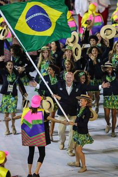 #RIO2016 Yane Marques flag bearer for the Brazilian delegation waves the Brazilian flag during the Opening Ceremony of the Rio 2016 Olympic Games at Maracana...
