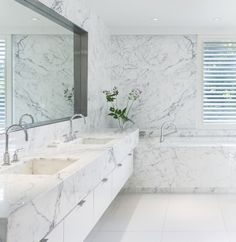 The luxurious master bath's walls, tub, and vanity are sheathed in polished Statuario marble, while the floors are paved in Thassos marble tile. | archdigest.com
