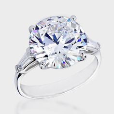6.0 Ct. Round  Baguette Solitaire  14K Ring. This beautiful high quality cubic zirconia ring features 6.0 carat brilliant round center with a single tapered baguette on each side. An approximate 6.50 total carat weight. This cubic zirconia ring is set in solid 14K white gold, and is available in 14K yellow gold via Special Order.  Cubic zirconia weights refer to equivalent diamond carat size.