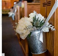 The Church Ceremony Featured Simple Decor, Such As White Flowers In .