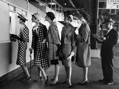 5 Models Wearing Fashionable Dress Suits at a Race Track Betting Window, Roosevelt Raceway in 1958