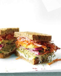 California Veggie Sandwich  Don't forget the vegetarians on your next picnic. This sandwich piles high crunchy cucumber, carrot, and radish and pairs them with creamy goat cheese, avocado, and sprouts for a sandwich that will please veggie-eaters from the West coast to the East coast.