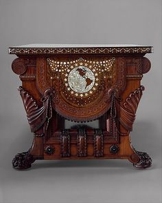 "1882 American (New York) Library table at the Metropolitan Museum of Art, New York - From the curators' comments: ""Between 1879 and 1882, Herter Brothers designed and decorated William Henry Vanderbilt's new Fifth Avenue mansion. This monumental table was the centerpiece of his library...Although called a library table, it was never intended for study per se; rather, it was a piece of sculpture and a monument to Vanderbilt himself."""