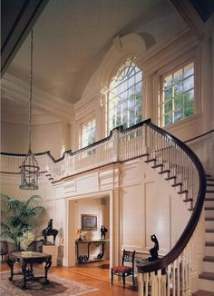 absolutely remarkable, large arched window over foyer & staircase