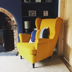 Lounge coming along nicely. Dulux Breton Blue and IKEA yellow Strandmon armchair. Love the colour contrast.