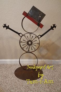 Junkyard Art by Tam-I-Am. Repurposed scrap metal come together as Rusty the Snowman.