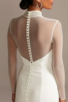Although unembellished, this stretch crepe wedding dress is anything but ordinary. The sleek silhouette is created from an illusion mesh mock turtleneck and long sleeves, which top a sweetheart neckli Crepe Wedding Dress, Long Wedding Dresses, Wedding Dress Styles, Wedding Gowns, Crepe Dress, Backless Wedding, Sleek Wedding Dress, Wedding Dress Topper, Long Sleeve Bridal Dresses