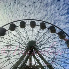 The great Ekka ferris wheel on a fairy floss sky