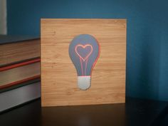 """Nathan Pryor's """"Your Love is the Light in my Life"""" - edge-lit acrylic and wood cut & engraved by @Ponoko."""