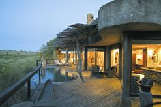 Singita- African Game reserve. I don't hunt but I'd start if it meant that I'd get to go here.