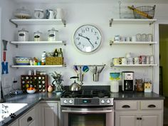It's amazing what a bright, light coat of paint can do for a dark kitchen. Check out the finished painted kitchen! - Dogs Don't Eat Pizza