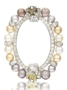 A vari-coloured natural pearl and diamond circlet brooch, by Cartier, circa 1915. The oval frame set with single-cut diamonds, issuing a surround of 16 vari-coloured natural pearls between old brilliant-cut diamond terminals of light pink and yellow tint, mounted in platinum, signed Cartier London, length 3.3cm, fitted case by Cartier. #Cartier #BelleEpoque #brooch