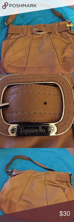 Tignanello tan colored leather pocketbook Tignanello tan colored leather pocketbook. Belt buckle style adorns this bag in the front. Inside zippered pocket with beautiful inside lining. A must have. Gently used. Tignanello Bags Shoulder Bags