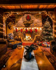 in a Cabin with a warm, cozy fireplace.Christmas in a Cabin with a warm, cozy fireplace. Why do we work so hard to make getting home simple? 🤔 Because it's where we eat together, of course! Noel Christmas, Country Christmas, Christmas Stockings, Cabin Christmas Decor, Christmas Decorations For The Home Living Rooms, Christmas Lights, Vintage Christmas, Christmas Place, Christmas Cactus