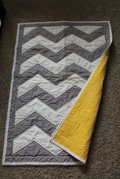 Jane's Girl Designs: Chevron Quilt Tutorial. I think this could make a really nice bigger quilt if bigger blocks were used and a wider border.