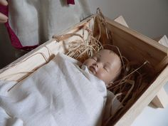 Six inch Heidi Ott baby makes a sweet baby Jesus in this nativity scene at Christmas.