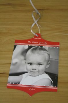 Decorate and String Photo Christmas cards and such to use as ornaments on your tree, etc... Awesome idea!!