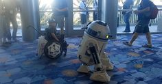 The force was very strong in one little boy who attended a Star Wars convention in California recently, as demonstrated by his shirt and storm trooper helmets!R2-D2 (operated by someone namedChris Lee) seemed to find a kindred spirit in the little boy, who was in a wheel chair and moved around in a sort ofsimilar pattern to R2. R2 started a sort of spin-dance contest with the boy.