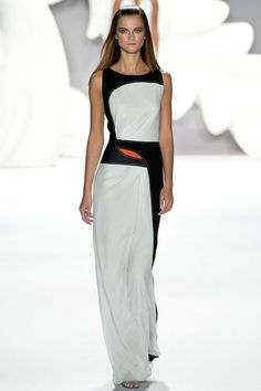 Even the smallest neon detail can freshen up a black and white silhouette.. Carolina Herrera