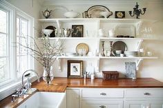 Country kitchen with wooden countertops - i found out through this blog that you can get butcher block countertops at IKEA they are very reasonable!!! SOOO EXCITED!!!